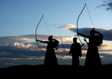 Japanese archer silhouette on sunset background